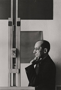 Mondrian in his studio at 353 East 52nd Street Photograph by Arnold Newman, 1941.